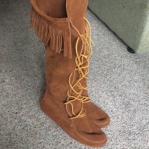 Knee high Minnetonka boots